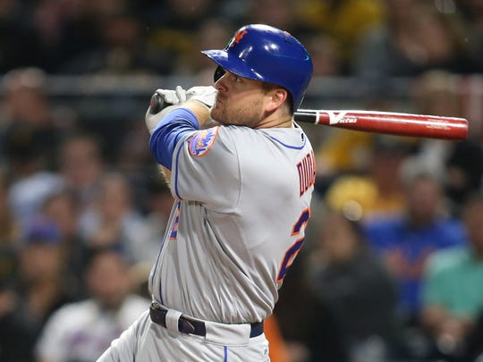 New York Mets right fielder Jay Bruce (19) hits a two run double against the Pittsburgh Pirates during the sixth inning at PNC Park on Friday, May 26, 2017.