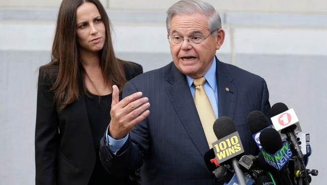 Sen. Bob Menendez talks to reporters as he arrives to court for his federal corruption trial in Newark as his daughter Alicia Menendez looks on. On the first day of the trial, Republican Lt. Gov. Kim Guadagno called for Menendez to resign if he is convicted of fraud and bribery charges. Guadagno is the Republican candidate hoping to succeed NJ Governor Chris Christie in the 2017 election.