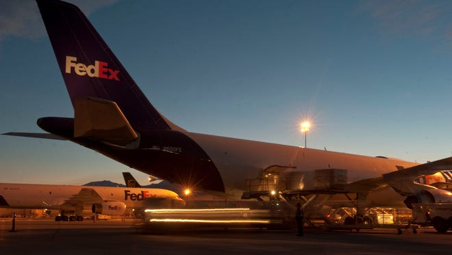 Cargo is unloaded from a FeEx plane at the Reno-Tahoe International Airport.