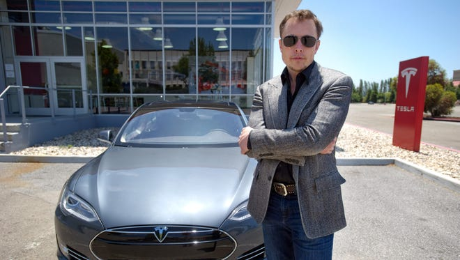 Elon Musk, CEO of Tesla, at the company's headquarters in Fremont, Calif.     , Cofounder, Chief Product Architect for Tesla with a new Model S  car outside the Tesla customer deliver area at the Tesla Fremont factory.   -- For story about entrepreneur Elon Musk and his next great adventure: the electric luxury sedan with 300 miles of range. He's unveiling the new Model S. We get a ride in the car with the designer and meet Musk for photo shoot/interview. --    Photo by Jessica Brandi Lifland, Freelance [Via MerlinFTP Drop]
