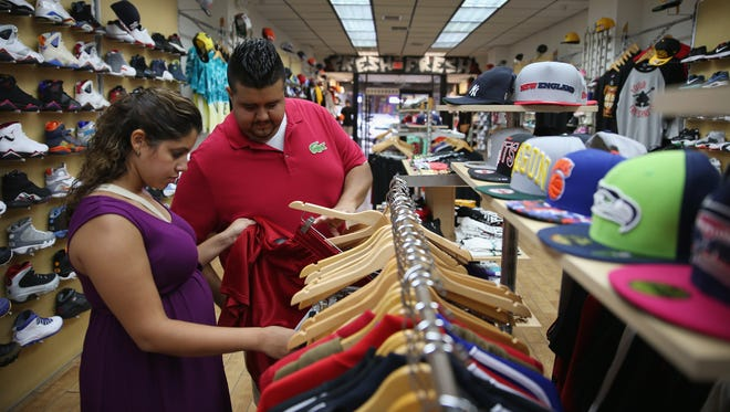 The University of Michigan reported Friday that consumer confidence fell in September for the second month in a row.
