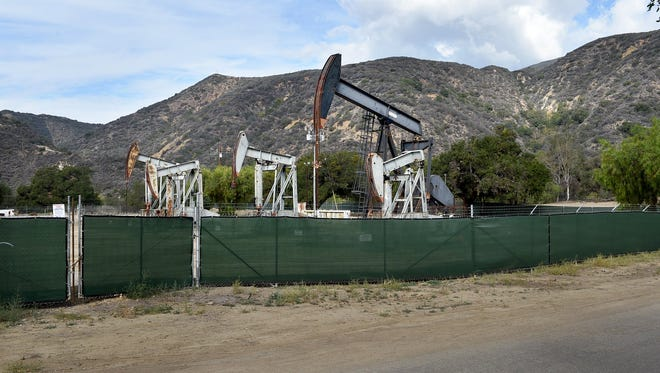 Oil wells tower above the Santa Paula Canyon trailhead.