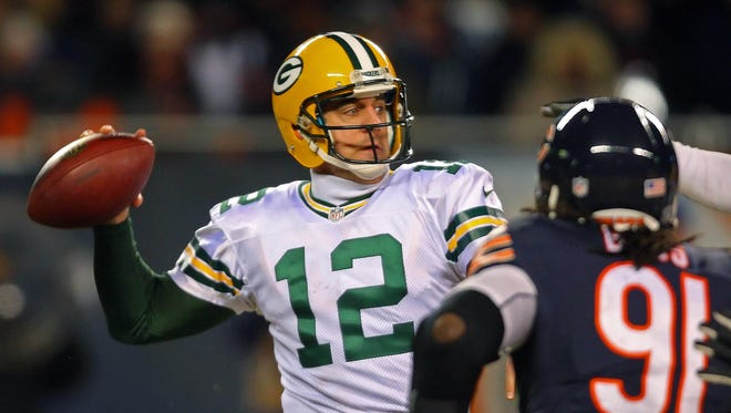 QB Aaron Rodgers led the Packers to the 2013 NFC North title with a Week 17 comeback in Chicago.
