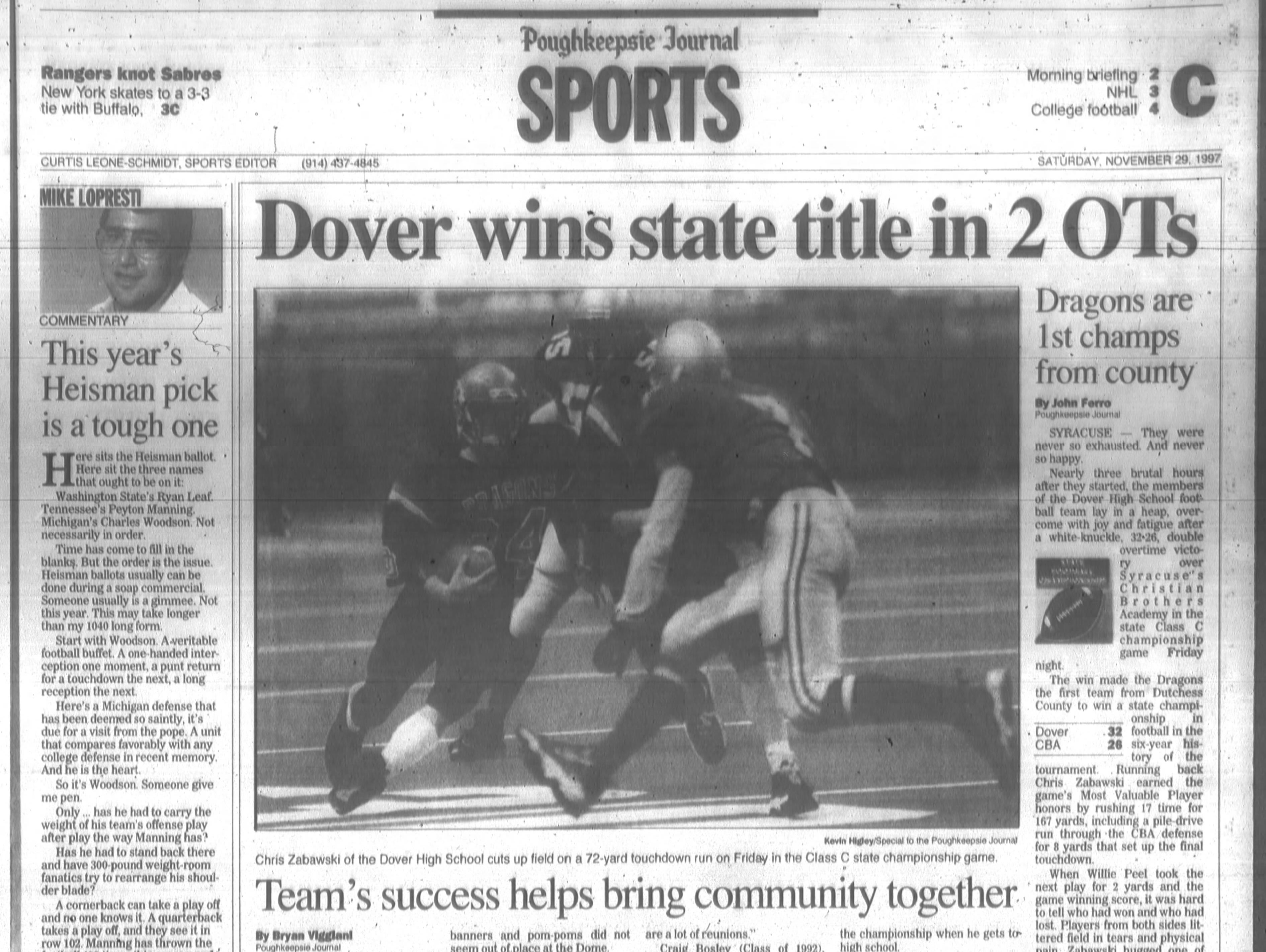 The Nov. 29, 1997 cover of the Journal's Sports section featured Dover High School's state football championship.