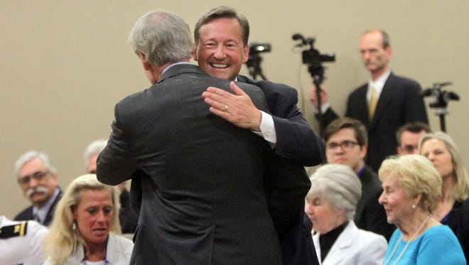Andre Bouchard gets a hug from Sen. Tom Carper during Bouchard's investiture ceremony May 23 as the new Chancellor of the Delaware Court of Chancery