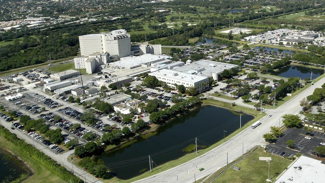 The Palm Beach County Sheriff's Office headquarters, center, and main jail, far left, face Gun Club Road west of Congress Avenue in suburban West Palm Beach. A $42 million renovation of the headquarters led Sheriff Ric Bradshaw to sign a four-year lease for $35,000-a-month space for top executives in Palm Beach Gardens.