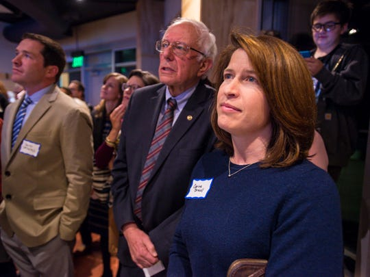Carinna Driscoll and her stepfather, U.S. Sen. Bernie Sanders, I-Vt., appear at a Vermont Democratic Party event in Burlington on Thursday, Nov. 9, 2017.