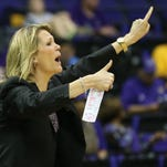 Albany Great Danes head coach Katie Abrahamson-Henderson yells to her team against the West Virginia Mountaineers in the first half of a women's college basketball game in the first round of the NCAA Tournament at the Pete Maravich Assembly Center.
