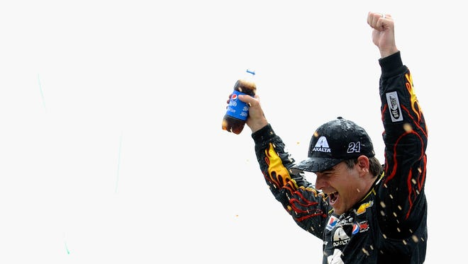 Jeff Gordon, driver of the #24 Axalta Chevrolet, celebrates in Victory Lane after winning the NASCAR Sprint Cup Series Pure Michigan 400 at Michigan International Speedway on August 17, 2014 in Brooklyn, Michigan.