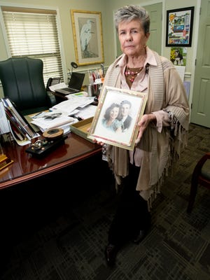 """Annalee Leonard, owner of Mainstay Financial, draws her inspiration to help others from a photograph of her parents. Leonard credits her father for her work ethic and drive to """"always do the right thing."""""""