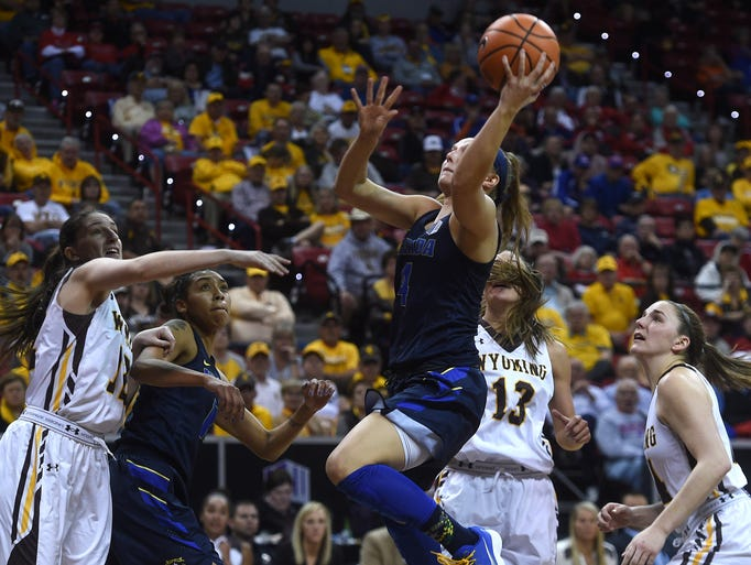 Nevada's Halie Bergman (4) shoots while taking on Wyoming