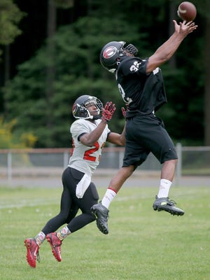 Kitsap Storm's Marcus Allen goes up for an interception against Rasharid Boman in practice on Tuesday.
