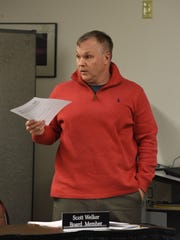 Tri-Valley Local Schools board member Scott Welker speaks during Thursday's meeting. He was reading a resolution banning board member Jason Schaumleffel from board-owned property without written permission from the board.