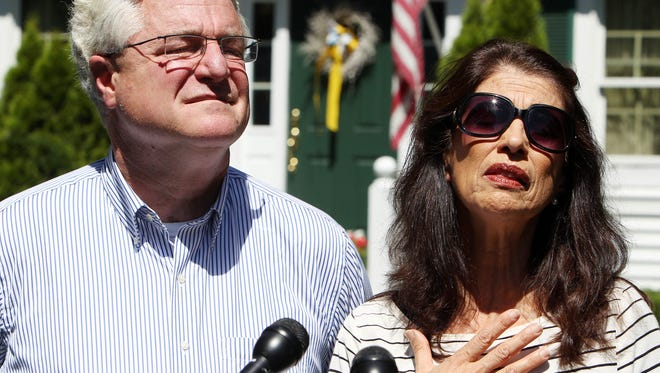 Diane and John Foley talk to reporters after speaking with President Obama on Aug. 20 outside their home in Rochester, N.H.