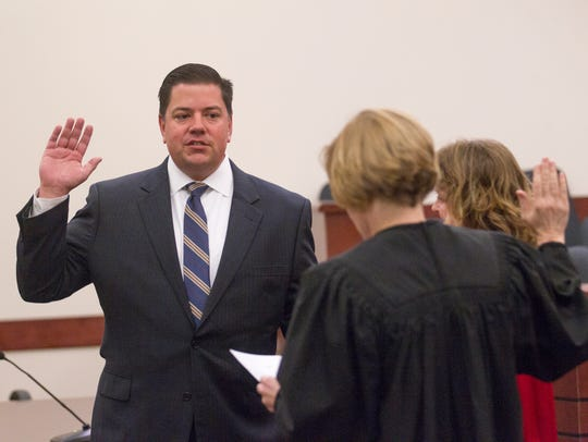 Erich Cole is sworn in as a magistrate court judge by Chief District Judge Karen Townsend on Friday in Aztec District Court.