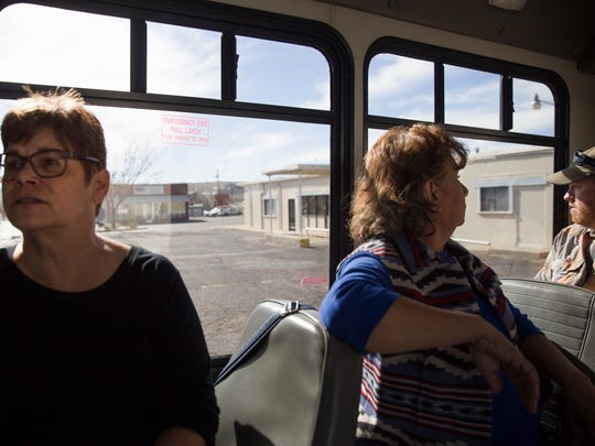 At left, Judy Castleberry, director of the Enterprise Center at San Juan College talks during a bus tour of Farmington during a business incubation conference for outdoor and recreation tourism on  Saturday, Feb. 3, 2018 at the San Juan College Quality Center for Business in Farmington.