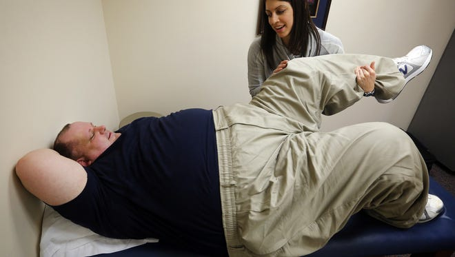 Daniel Finney, the Register's Metro Voice columnist, works with physical therapist Stefanie Kirk Tuesday, March 31, 2015.
