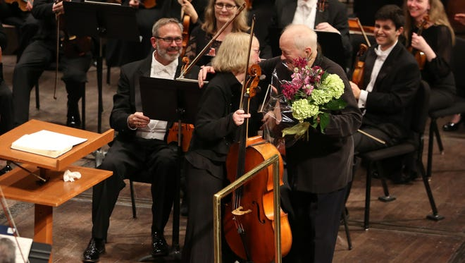 Maestro Edo de Waart gives retiring cellist Elizabeth Tuma a hug and a bouquet of flowers after the Milwaukee Symphony performed Mahler's Symphony No. 3 in May at the Marcus Center.