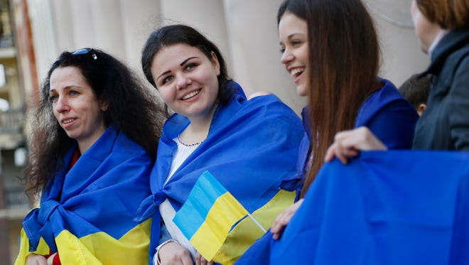 Pro-Ukrainian activists hold Ukrainian flags during a protest in Donetsk, eastern Ukraine, on Tuesday.