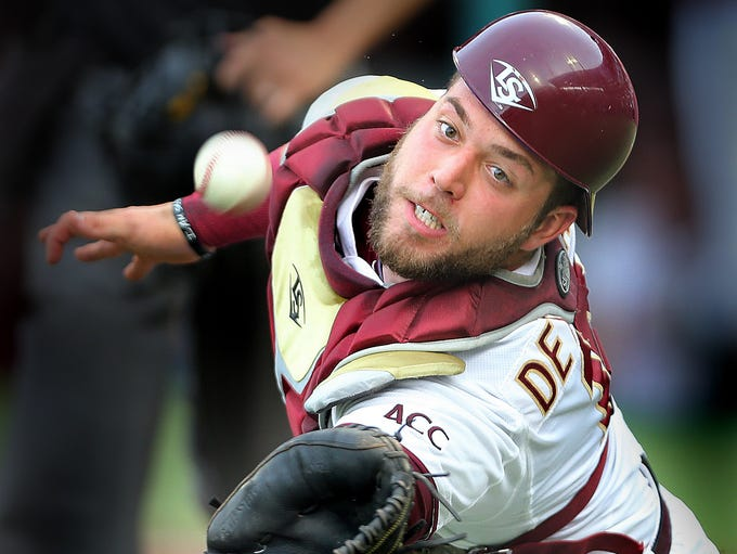 FSU  catcher  Danny De La Calle dove to make a spectacular  catch to foil a bunt attempt on Friday. It wasn't enough. The Florida State Seminoles took one on the chin and managed just two hits as they were shutout by the 4th seeded Georgia Southern Eagles, 7-0 on Friday, May 30, 2014.