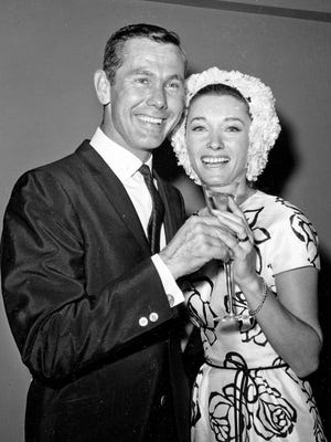 This Aug. 17, 1963 file photo shows comedian Johnny Carson and his second wife, former television personality and model Joanne Copeland, at a reception in his apartment after their wedding.
