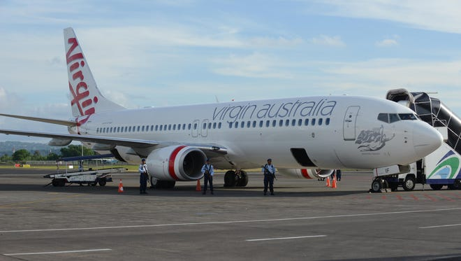 Armed Indonesian Air Force soldiers secure the Virgin Australia 737-800 plane at the tarmac of Denpasar airport in the resort island of Bali on April 25.