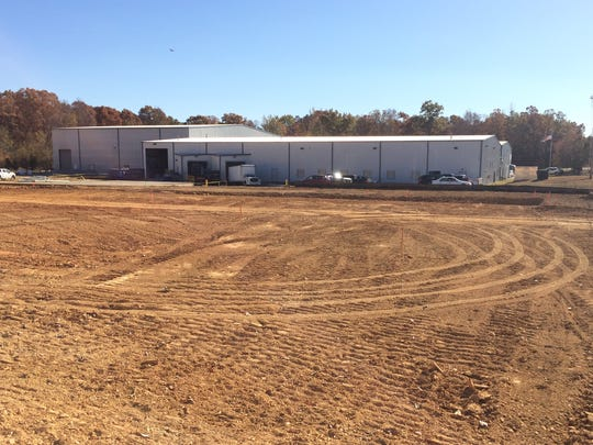 The site where Truform will expand by next year, adding 75 jobs, with the current facility in the background.