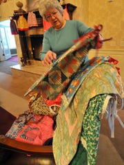 Resident Mary Aton, 79, sorts dresses at Birchwood Highlands in Weston.