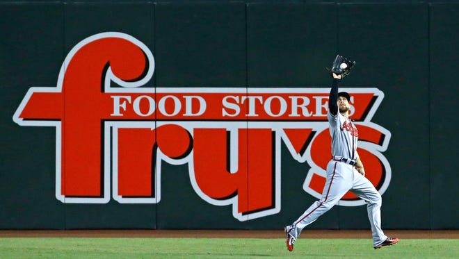 Atlanta Braves center fielder Ender Inciarte (11) catches a deep fly by Arizona Diamondbacks' Mitch Haniger (19) in the 2nd inning of their MLB game Tuesday, Aug. 23, 2016 in Phoenix,  Ariz.