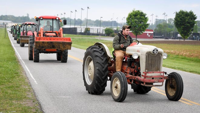 On Friday morning, Future Famers of America students at Henderson County High get to drive their farm tractors in a parade down Garden Mile Road as a reward for a third place finish at the Murray State University FFA Field Day.