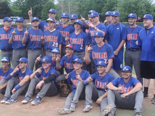 Members of Garden City's baseball team pose with their district-championship trophy.