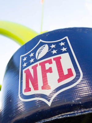 Aug 23, 2013; Green Bay, WI, USA; The NFL Logo on the goalpost padding during warmups prior to the game between the Seattle Seahawks and Green Bay Packers at Lambeau Field.  Seattle won 17-10.  Mandatory Credit: Jeff Hanisch-USA TODAY Sports