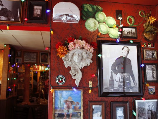 Pictures and statues decorate every wall of the Buca