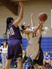 Eastwood's Kaylee Martinez drives to the basket defended