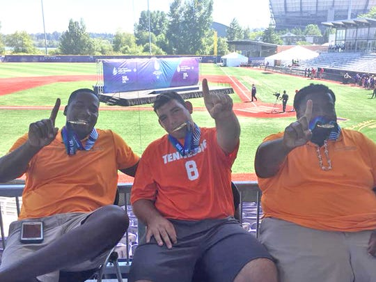 Fairview's Hunter Hammon (center) with his Team Tennessee coaches Christian Robinson and Dominique Greene after winning their gold medals at the 2018 Special Olympics USA Games in Seattle, Washington.