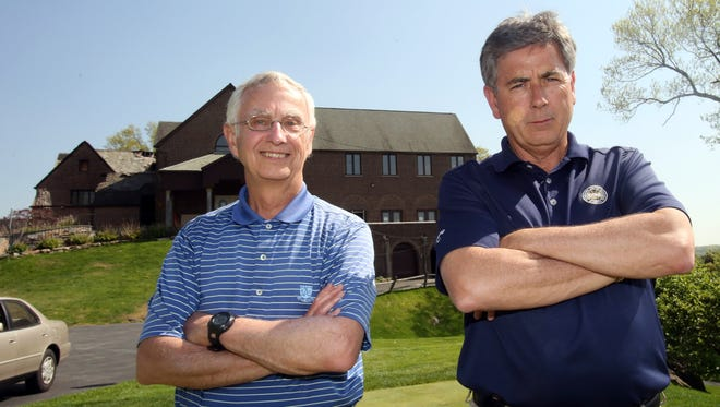 Ardsley Country Club president Peter Hofmann, left, and golf pro Jim Bender are photographed this month outside the clubhouse, where a major fire took place.