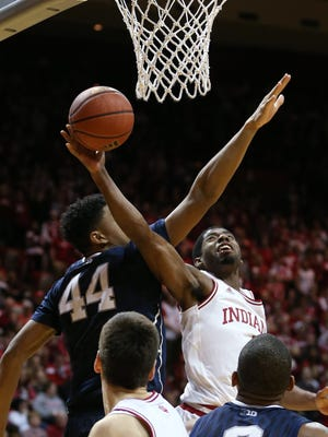 Indiana Hoosiers guard Robert Johnson goes up for two points in the second half against Penn State Nittany Lions forward Julian Moore. Indiana hosted Penn State at Assembly Hall on Tuesday, January 13, 2015.