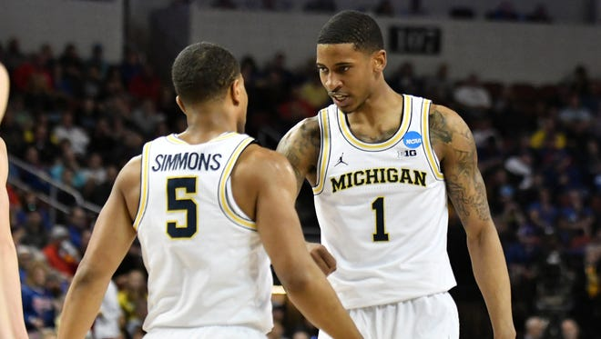 Michigan guard Charles Matthews (1) talks with Michigan guard Jaaron Simmons (5) in the first half. Michigan vs Montana in the first round of the Men's NCAA Tournament at INTRUST Bank Arena in Wichita, Kan. on March 15, 2018.