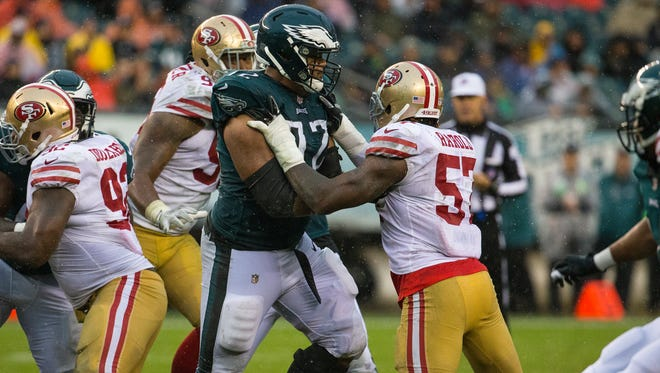 The Eagles' Halapoulivaati Vaitai blocks during their game against the 49ers Sunday at Lincoln Financial Field. Vaitai took the place of veteran tackle Jason Peters who was injured last Monday against the Redskins.