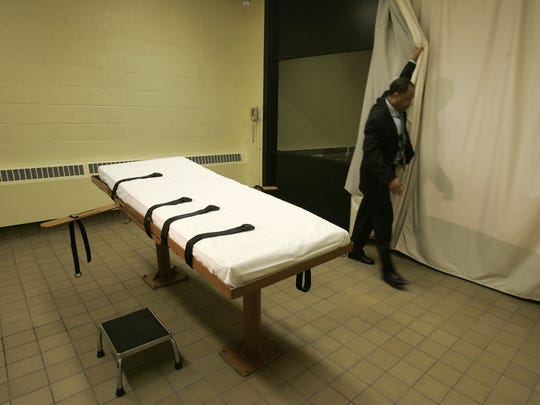 In this Nov. 2005 file photo, public information director Larry Greene is shown in the death chamber at the Southern Ohio Correctional Facility in Lucasville, Ohio. The state prisons agency announced Monday, June 29, 2015, that Ohio will test lethal injection drugs ahead of executions if it obtains specialty batches of the drugs, in its latest update of capital punishment rules.