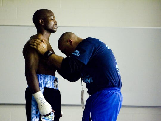 Timothy Bradley at left focuses with trainer Joel Diaz minutes before he is to go in the ring to fight Devon Alexander for the WBO-WBC unification bout at the Silverdome in Pontiac, Michigan on January 29, 2011.