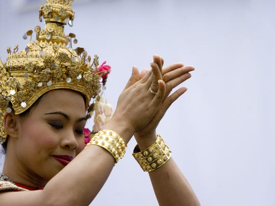 Rungnapha Chimphut of Thailand, performs a dance called Kritda Phinihan during the Asian Festival at Heritage Square in Phoenix.