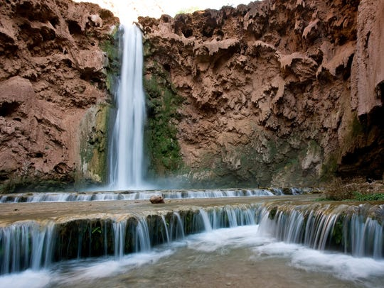 Water flows from Mooney Falls, one of the Havasupai