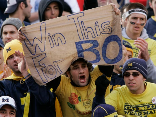 A Michigan fan holds a sign for Bo Schembechler, who died one day before the 2006 Michigan vs. Ohio State game.