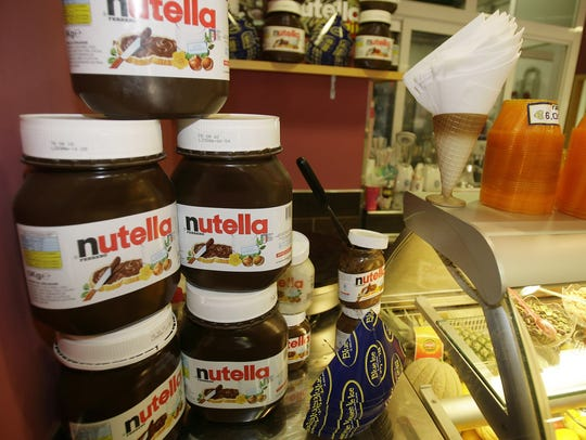 Nutella pots on display in a creperie in Rome.