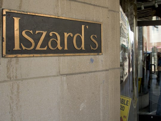 The Iszard's sign and the curved glass windows by the