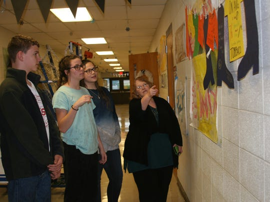 Tawana Manning with the Arkansas Department of Health's Tobacco Prevention & Cessation Program speaks with Cotter seventh graders Hadley Ward, Logan Principato, Hudson Adams, Becca Bennedict, and Payton McGee. Students signed a banner indicating they would be the first smoke free generation.