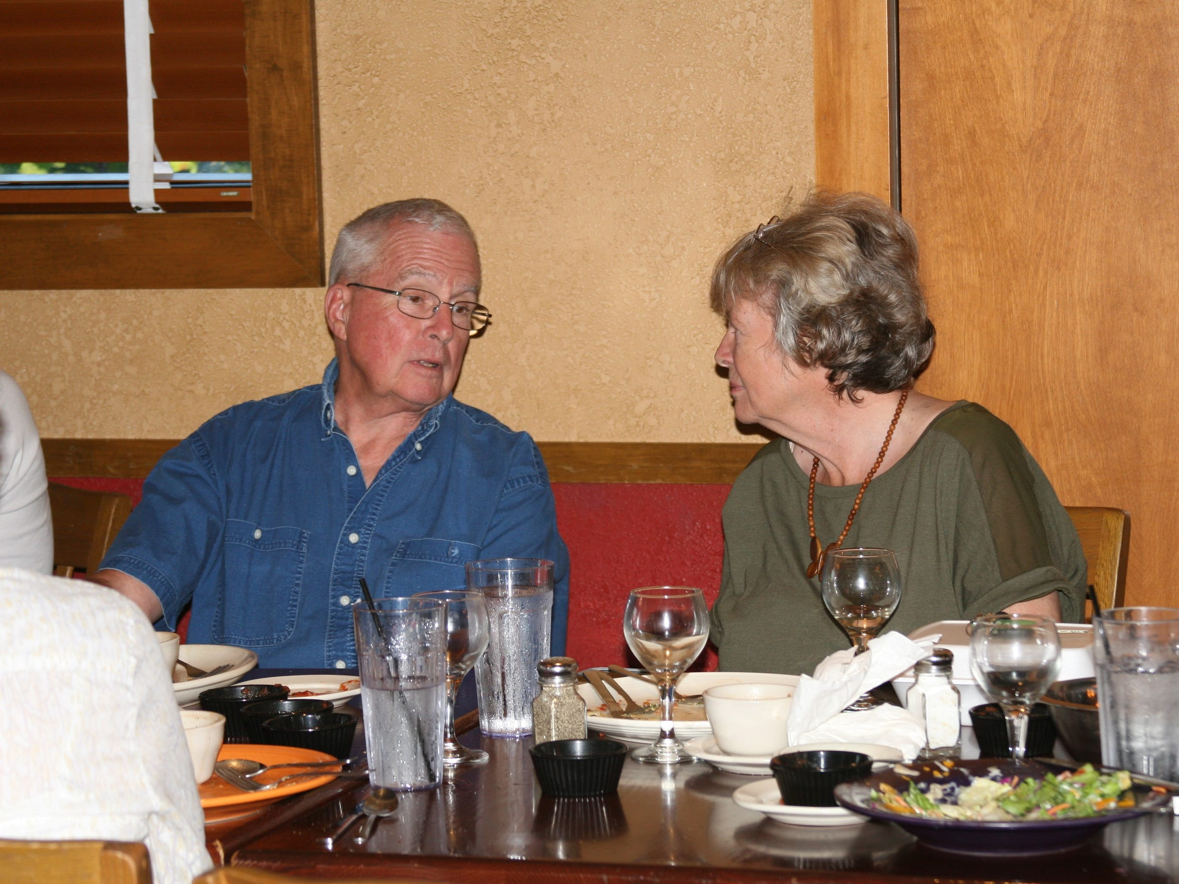 Jane Darr of Cotter and Bill Weeks Lockyer of Mountain Home, both members of St. Andrew's Episcopal Church enjoy fellowship and food at El Chico's as part of the church's Pub Theology program.