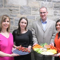 Four of the dieticians participating in the Poughkeepsie Journal's dial-a-dietitian program pose with plates of fruits and vegetables. From left to right: Annette Cuevas, retail registered dietitian at ShopRite of Dolson Avenue and of Wallkill; Kelly Pearson, retail registered dietitian at ShopRite of Montague; Christopher S. Esola, clinicial dietitian at Health Alliance of the Hudson Valley; and Tanya L. Lopez, registered dietitian and president of Mid-Hudson Dietetic Association.