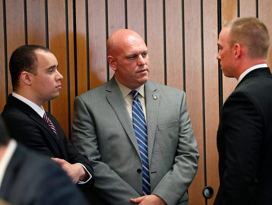 IMPD officers Carlton Howard, left, and Michal Dinnsen,